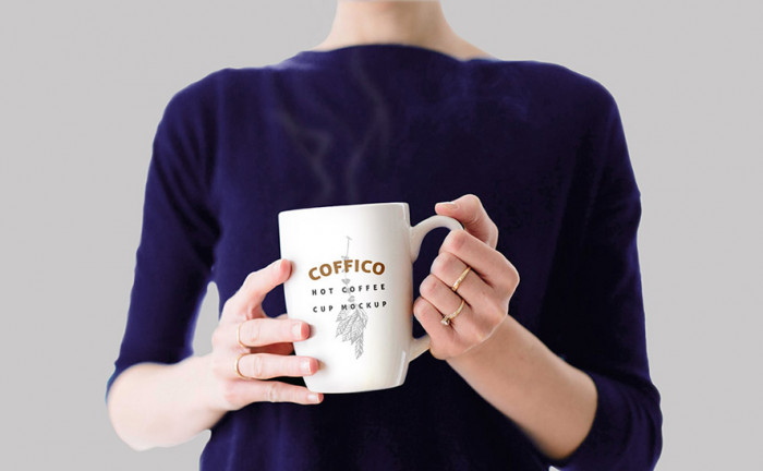 woman-holding-coffee-mug-mockup-psd